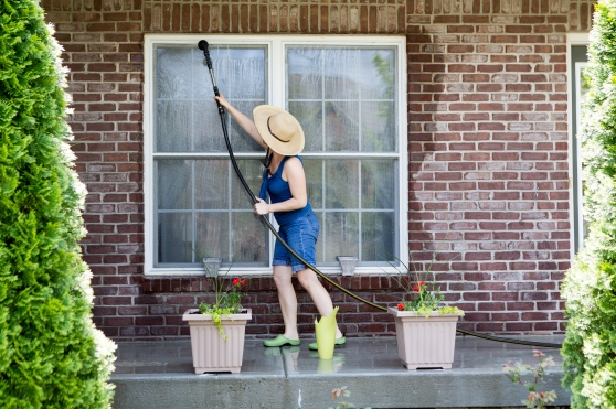 bigstock-Housewife-Washing-The-Windows--90077612.jpg